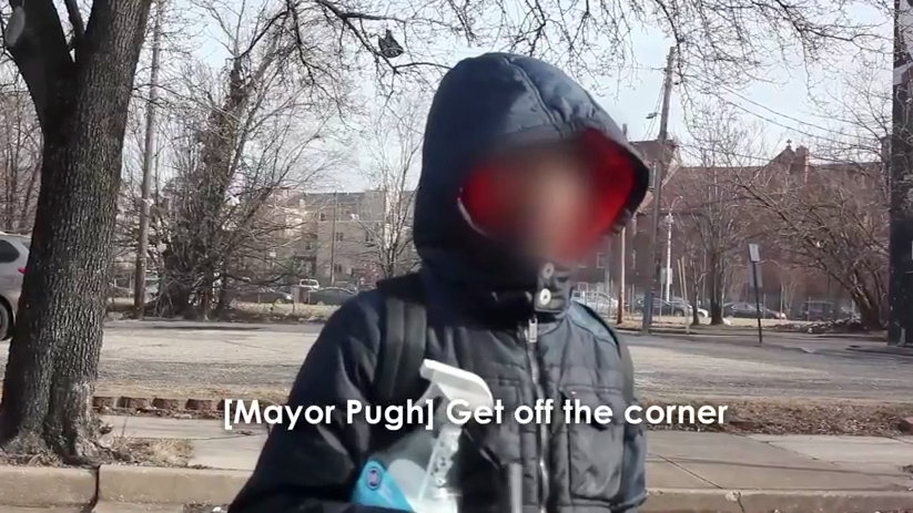 A child with a spray bottle and squeegee Mayor Catherine Pugh encountered Thursday on a Baltimore Street. (YouTube)
