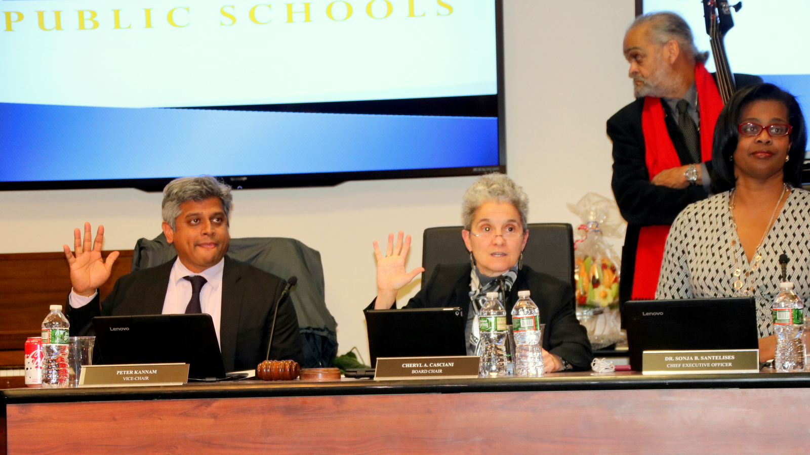 (From left) Peter Kanam, Cheryl Casciani and Sonja Santelises at the start of city school board meeting. (Fern Shen)