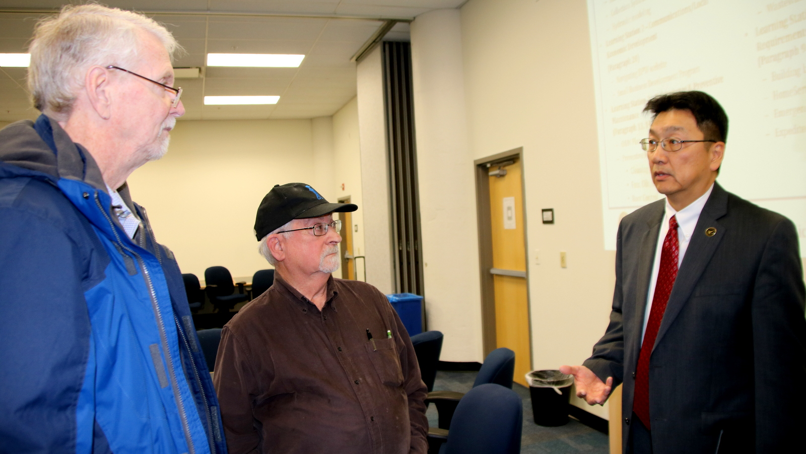 From left, Roger Gookin and Larry Fogelson, of the Green Towson Alliance, question Baltimore DPW chief Rudy Chow. (Fern Shen)