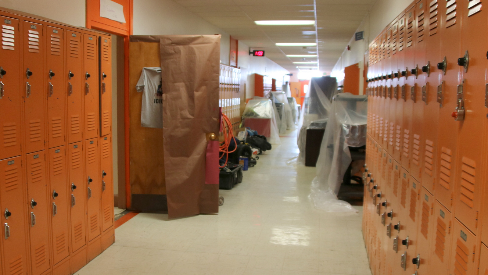 Desks, overhead projectors and other classroom items protected from leaks in the hallway at Frederick Douglass. (Fern Shen)