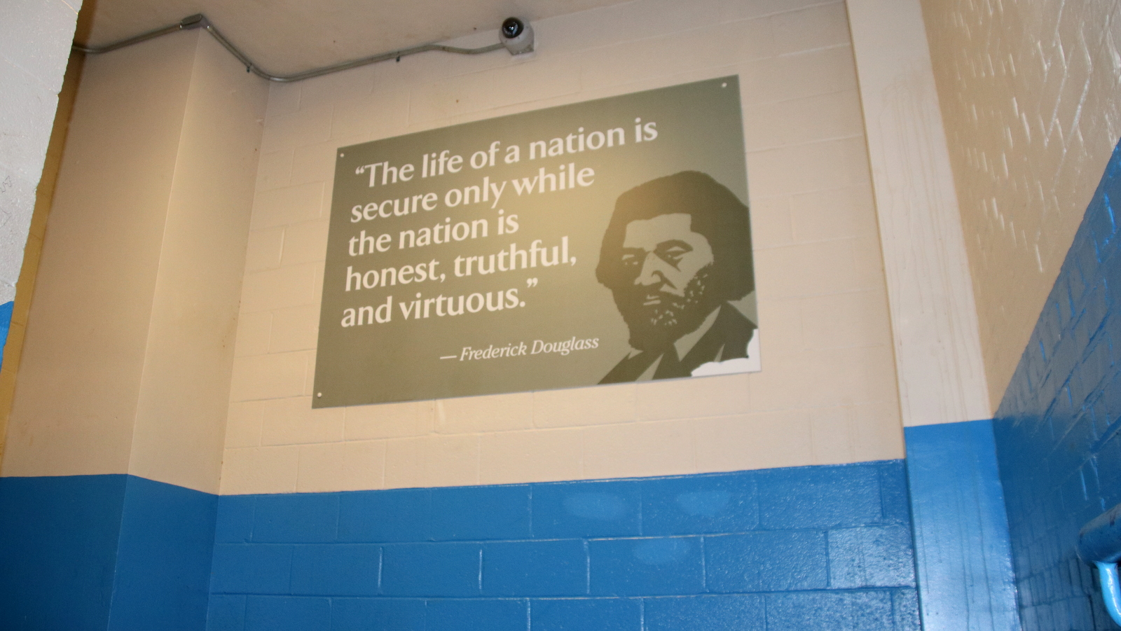 Sign in the stairwell with a quote from the school's namesake. (Fern Shen)