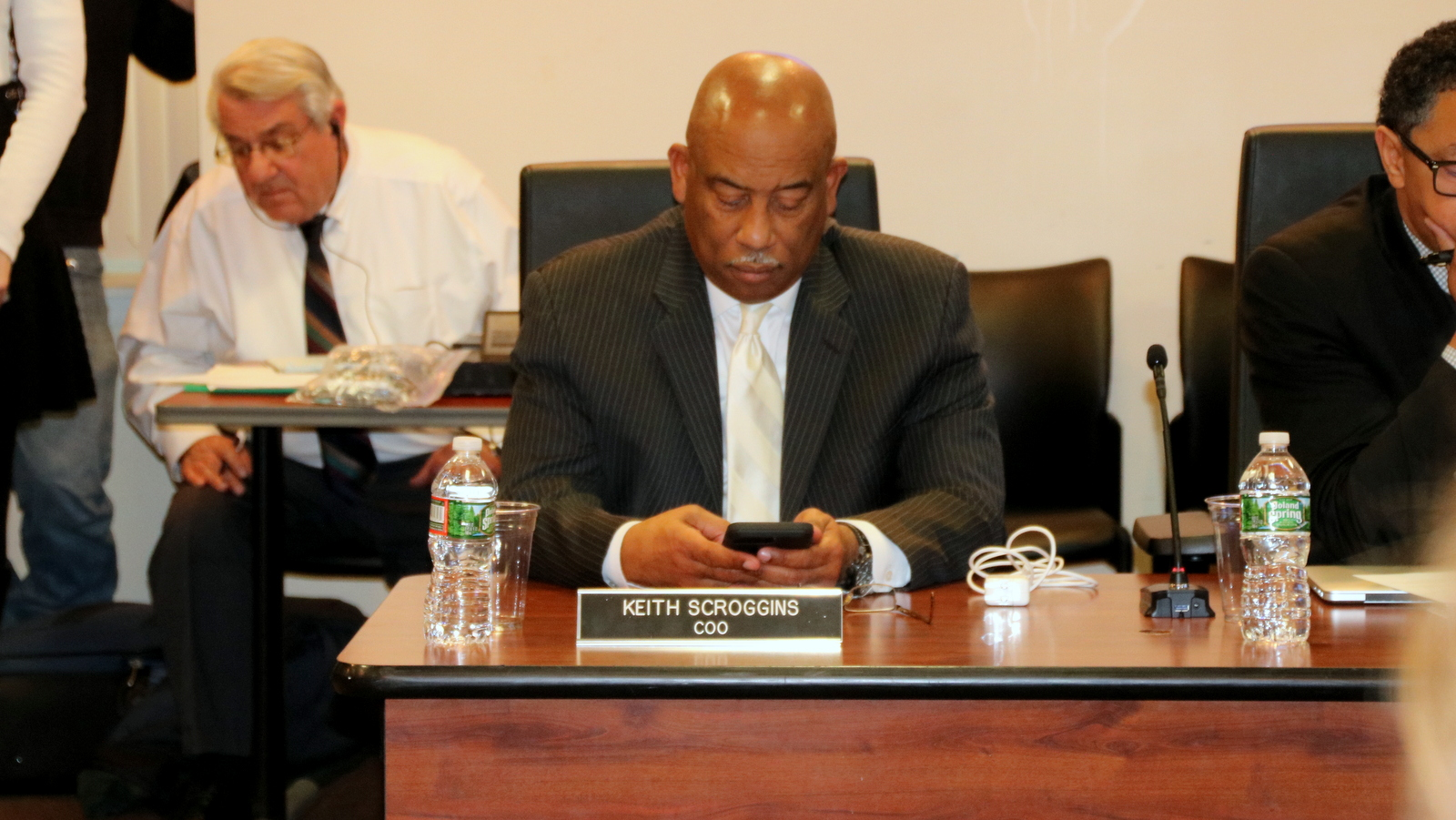 City Schools COO Keith Scroggins waits for the meeting to begin. (Fern Shen)