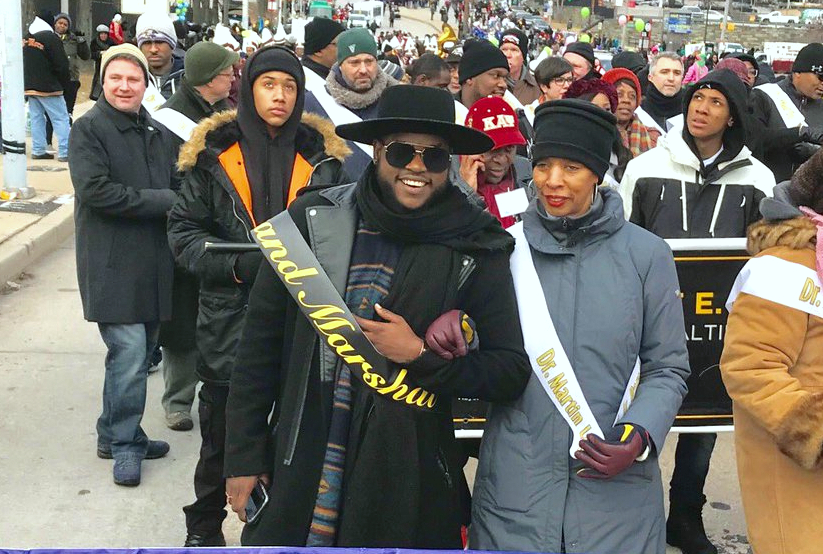 Named grand marshal of the 2018 Martin Luther King Jr. Parade, Davon Fleming walks arm-in-arm with Mayor Pugh. (@MayorPugh50)