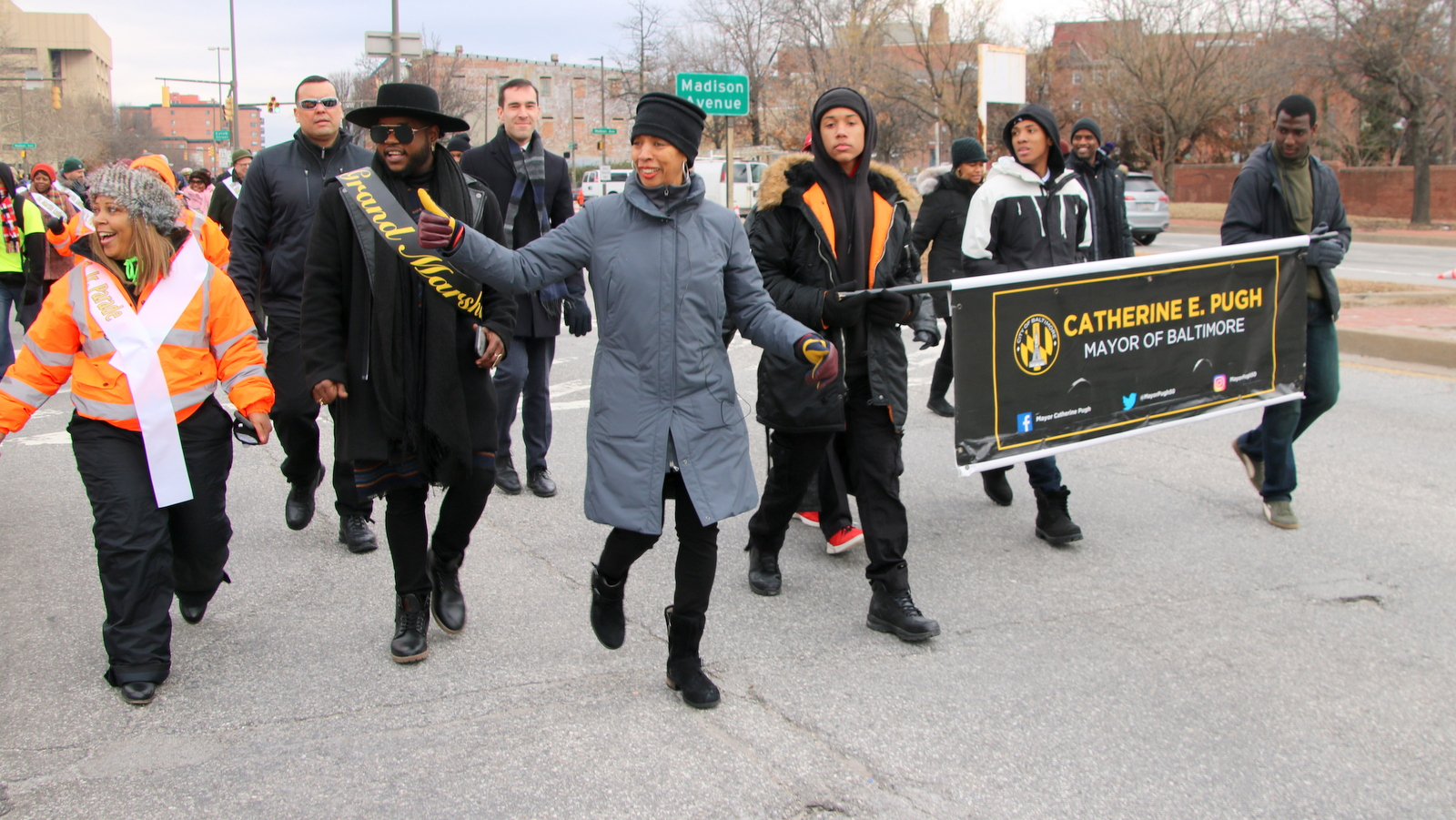Grand Marshall Davon Fleming and Mayor Catherine Pugh lead Baltimore's Martin Luther King Day Parade. (Fern Shen)