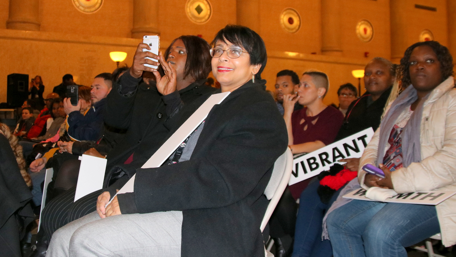 Kim Morton attends at the mayor's candlelight vigil of crime victims last December with Samantha Smith, a former Tent City homeless leader who briefly served as Mayor Pugh's LGBT liaison. (Fern Shen)