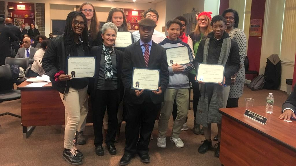 Members of the student group Baltimore Beyond Plastic with chair school board chair Cheryl Casciani and CEO Sonja Santelises as the school board votes to phase out foam trays. (Facebook)