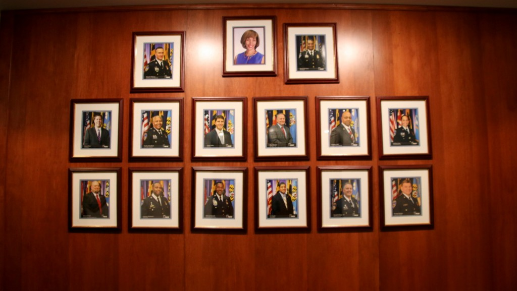 A photo of Deputy Commissioner Dean Palmere, top left, on the wall at police headquarters last week. (Fern Shen)