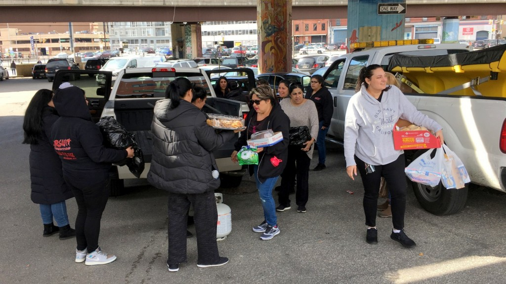 Members of the Gateway Church, of Glen Burnie, barred from setting up a food give-away at an encampment of homeless people because the city was about to clear it. (Fern Shen)