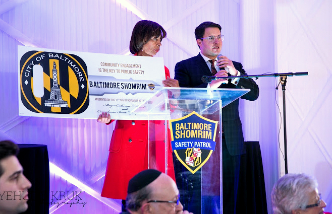 Mayor Catherine Pugh and Councilman Schleifer announce the purchase of Shomrim's Chevy Tahoe patrol car at the Shomrei Emunah Banquet Hall last November. (Baltimore Jewish Life)