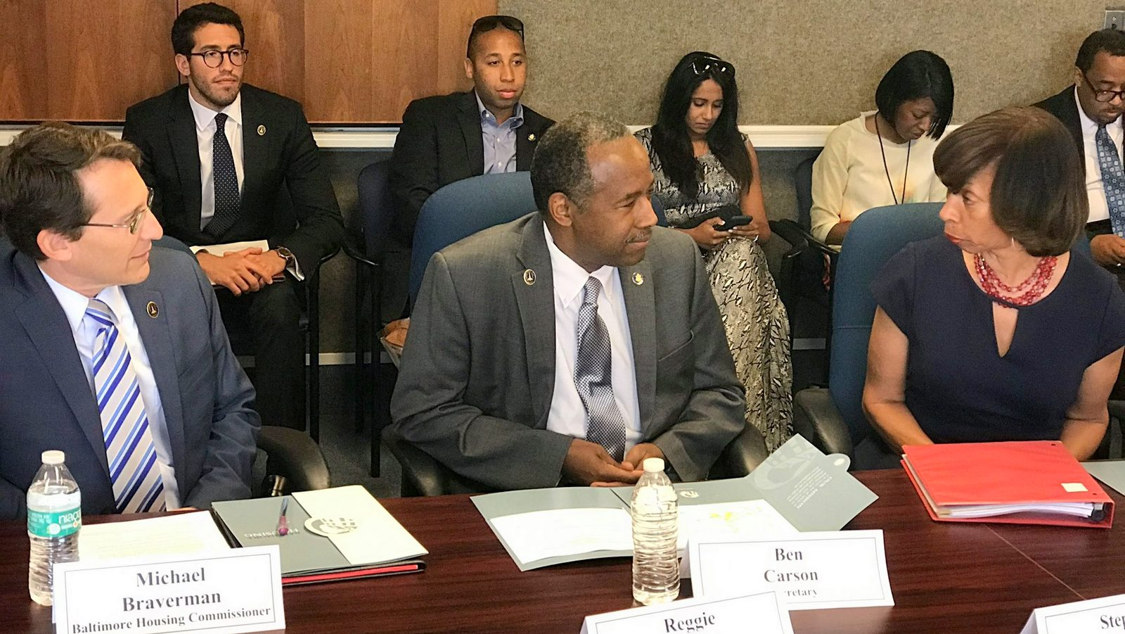 Baltimore Housing Commissioner Michael Braverman (left) and Mayor Catherine Pugh (right) discuss the city's housing needs with U.S. Sec. of Housing and Urban Development Ben Carson. (Mayor's Office)