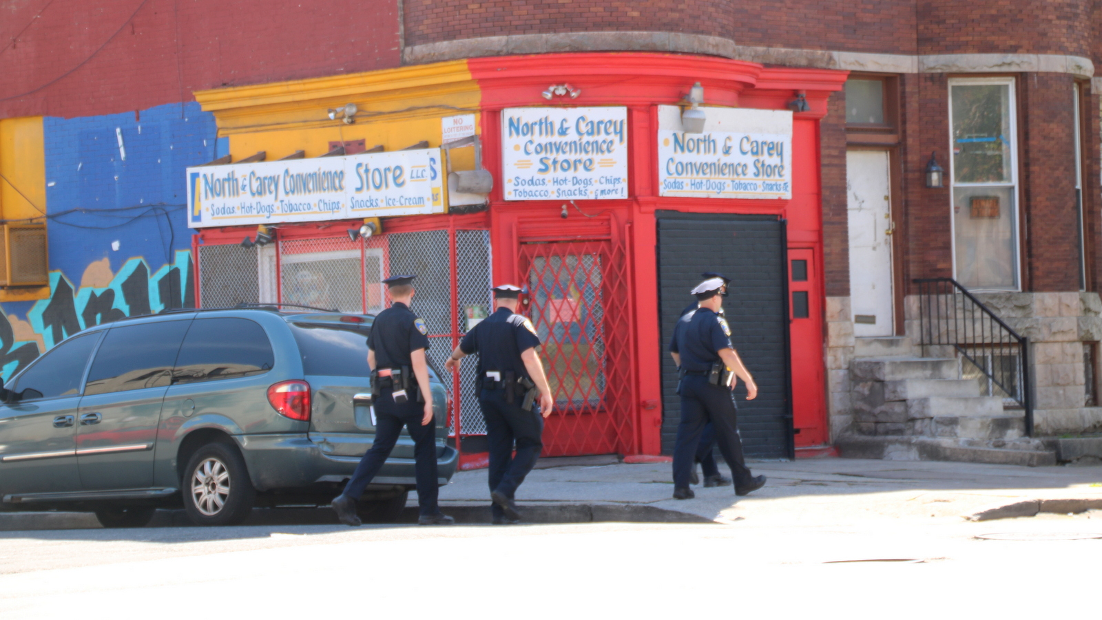 On North Avenue yesterday, Baltimore Police were highly visible walking the streets and entering stores. (Fern Shen)