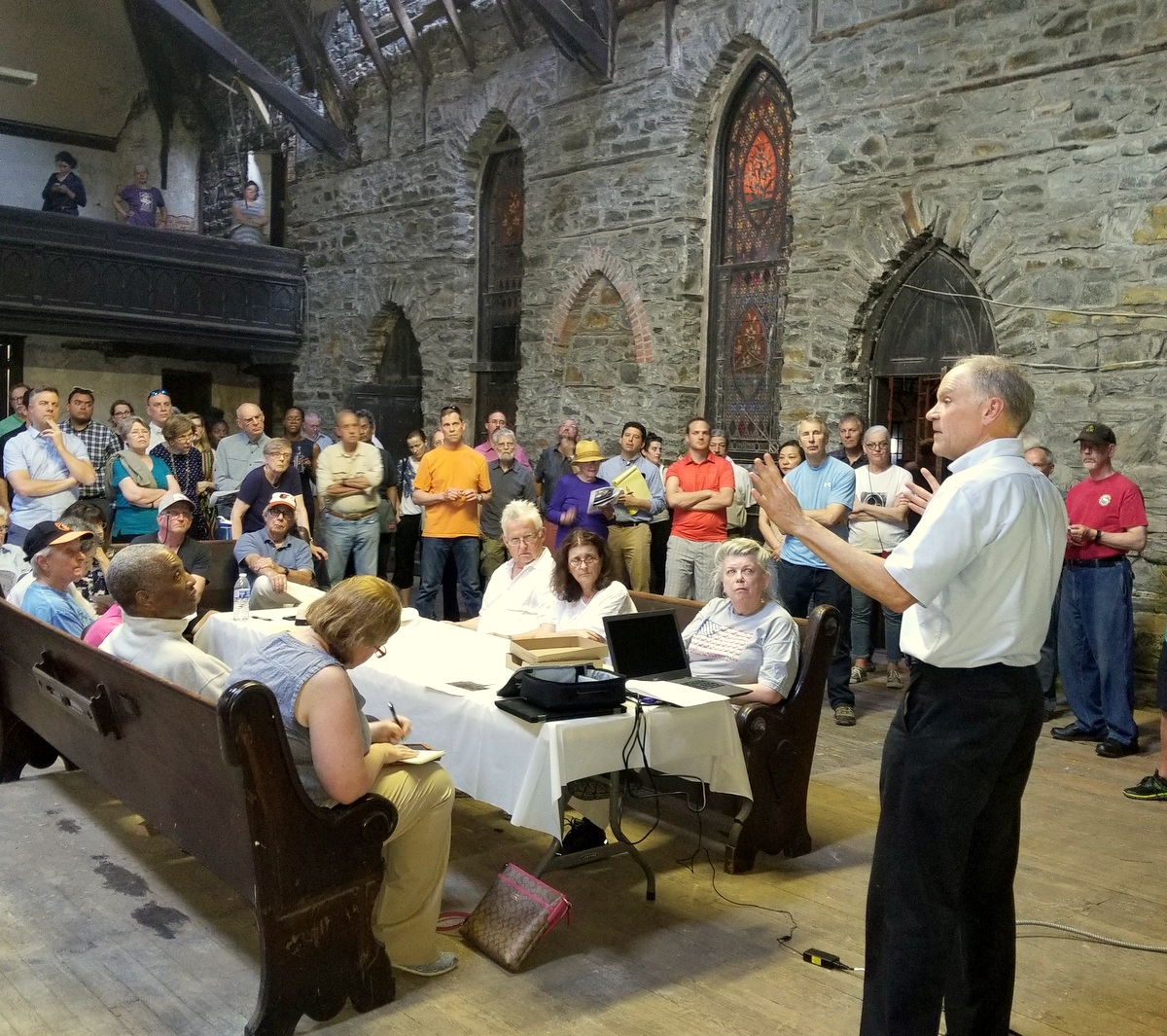 Ben Fredericks III addresses community residents inside the long-vacant Gothic Revival church. (Ed Gunts)