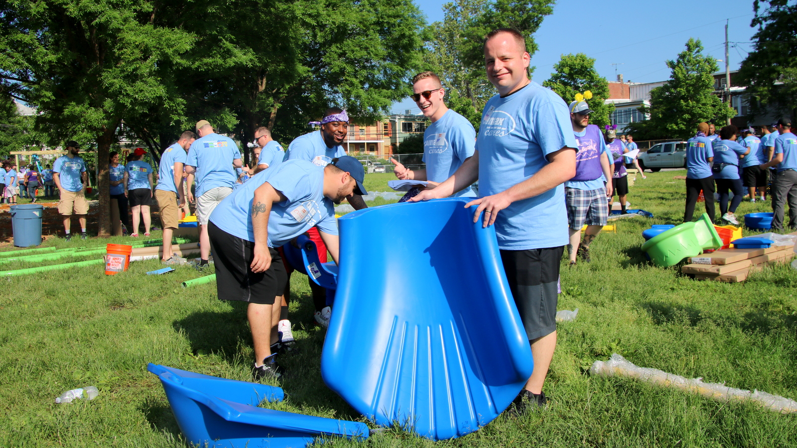 Volunteer partners from Carmax join community members to help build a new playground behind Barclay Elementary School. (Fern Shen)