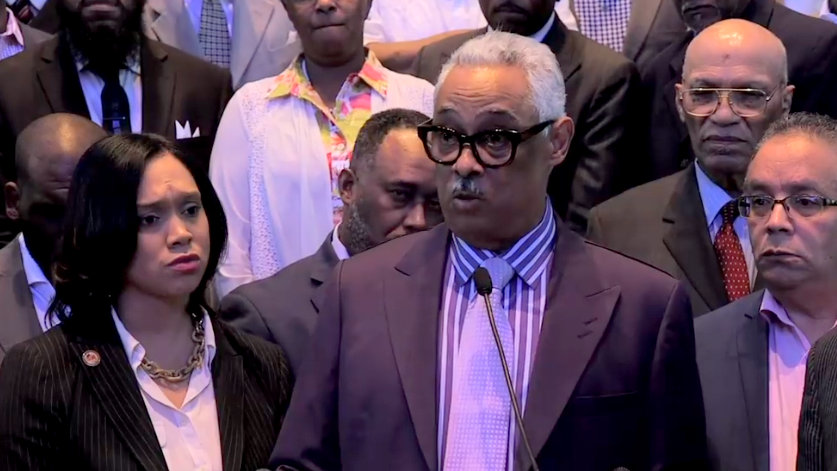 State's Attorney Marilyn Mosby listens as Bishop Frank Reid III and other ministers endorse her bid for re-election, in a video her campaign tweeted today.