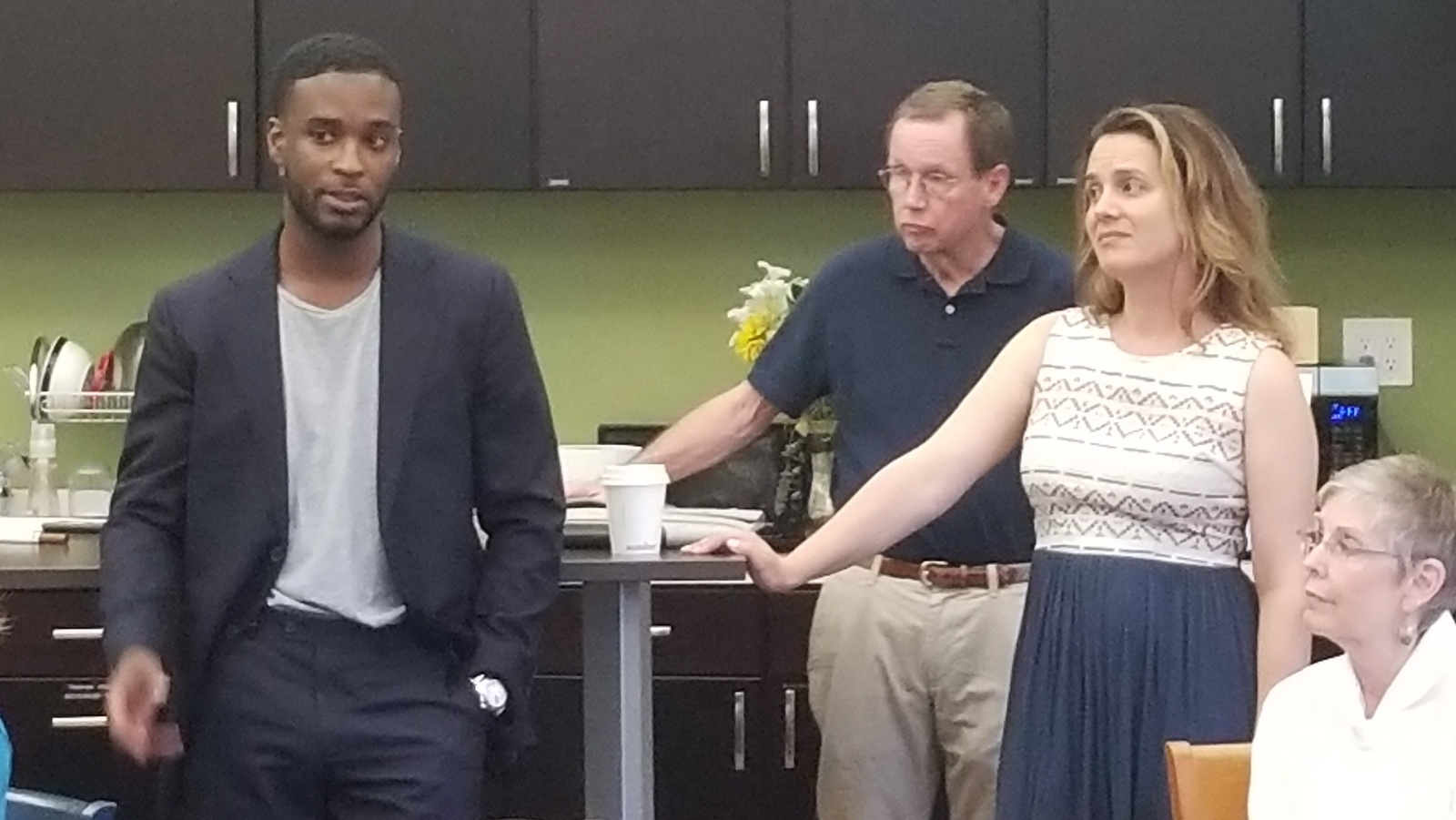 Developer Chris Mfume, consultant Al Barry and architect Pavlina Ilieva at a Woodberry Community Association meeting. (Ed Gunts.)