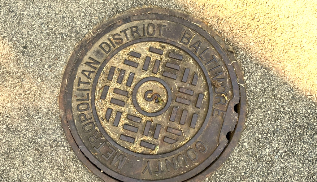A Metropolitan District manhole cover. Nearly 2/3rds of the water and sewer pipes in the District are more than 50 years old, with the highest percentage installed in the 1950s. (Mark Reutter)