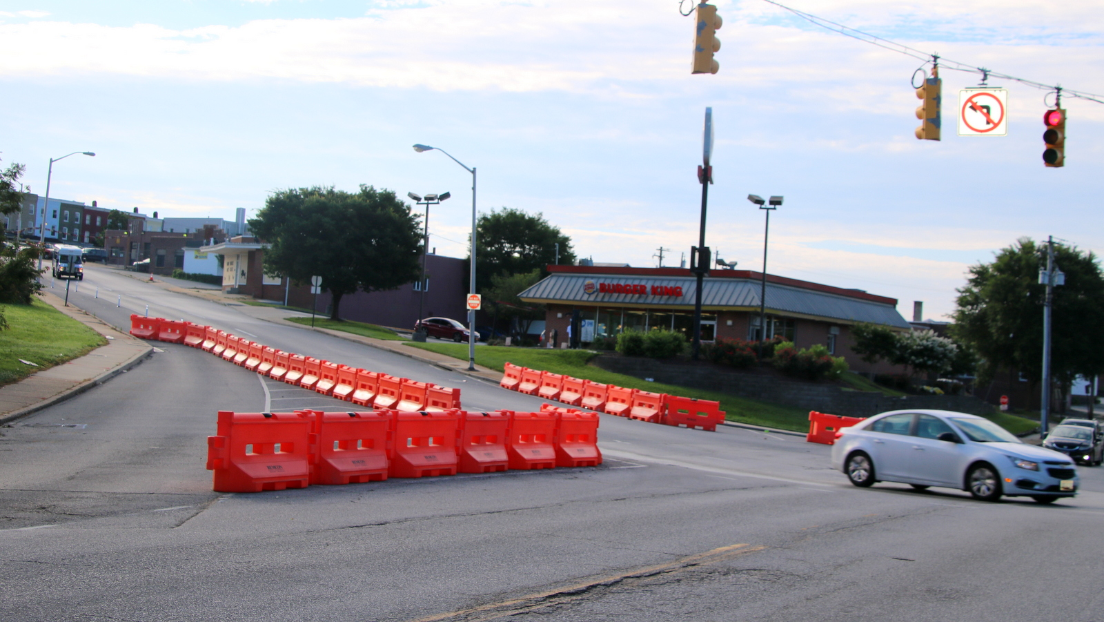 New barriers narrow the distance bikers and walkers must traverse to get across 29th Street at the Sisson Street intersection. (Fern Shen)