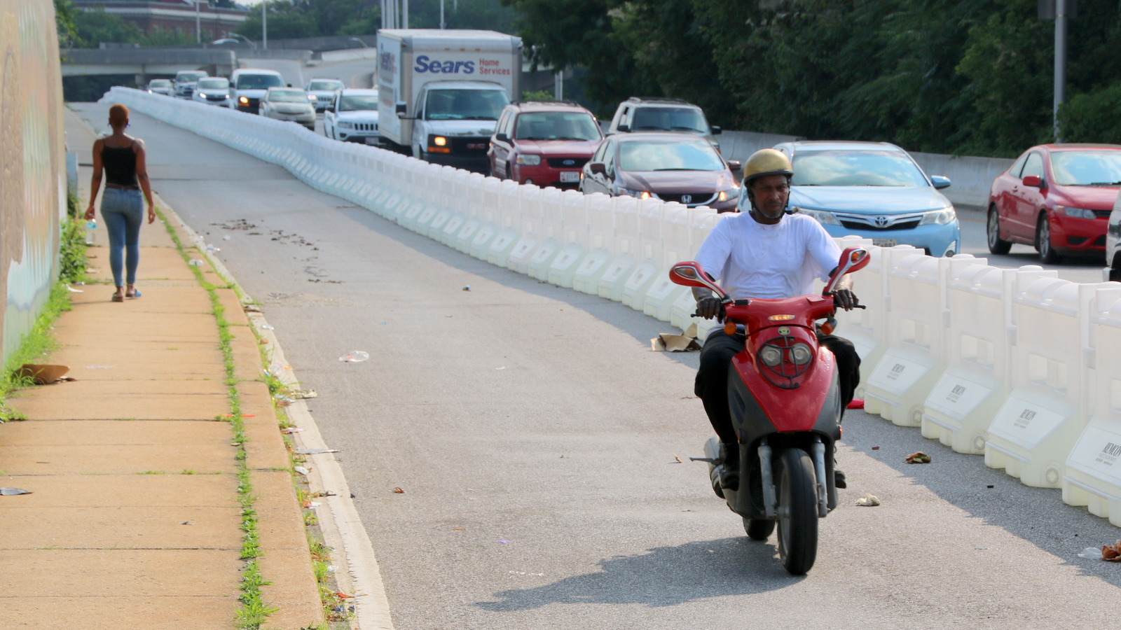 A pedestrian and a motorcycle rider in the new Big Jump lane. (Fern Shen)