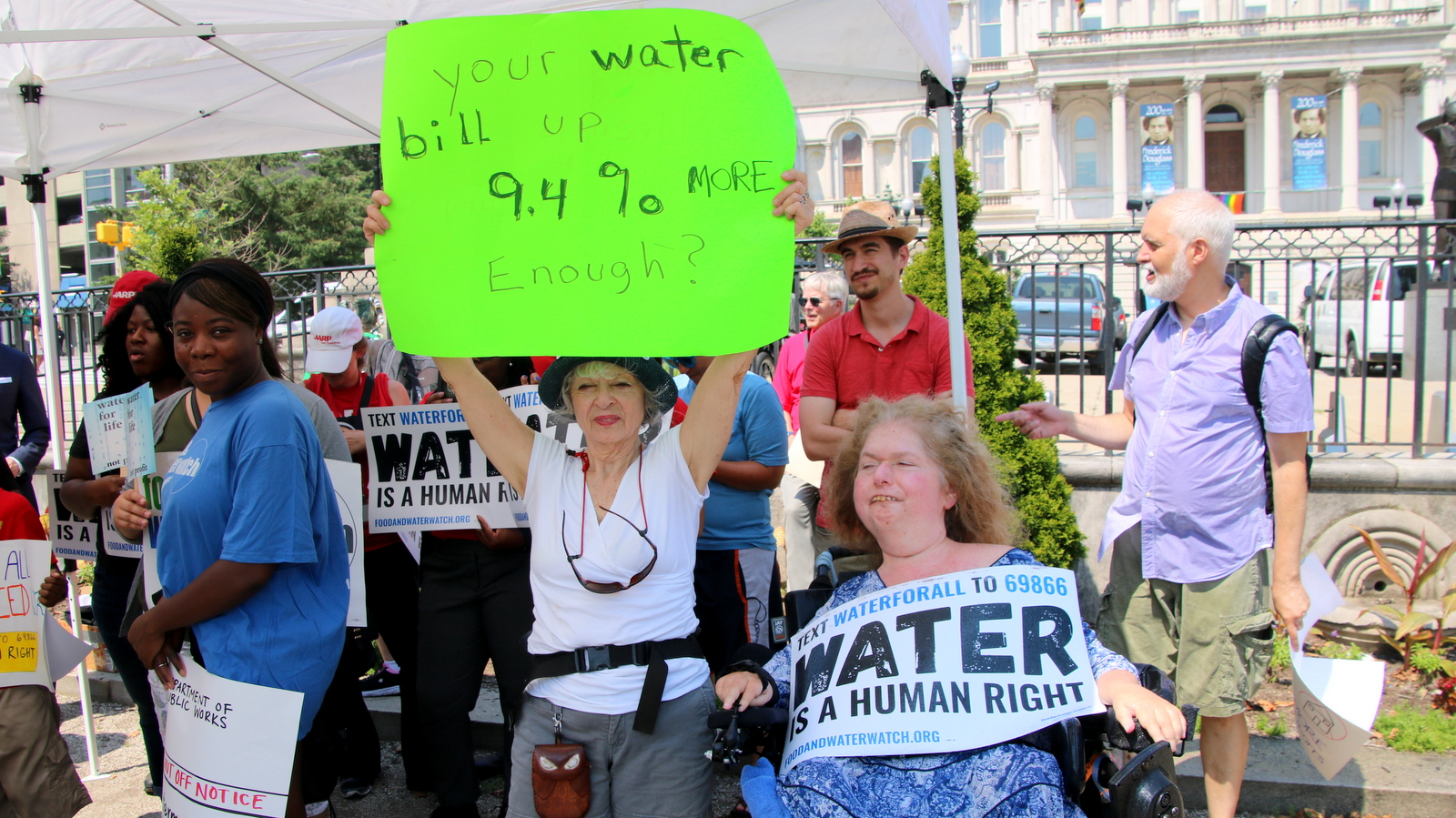 In the wake of a nearly 10% water bill rate hike, protesters chant