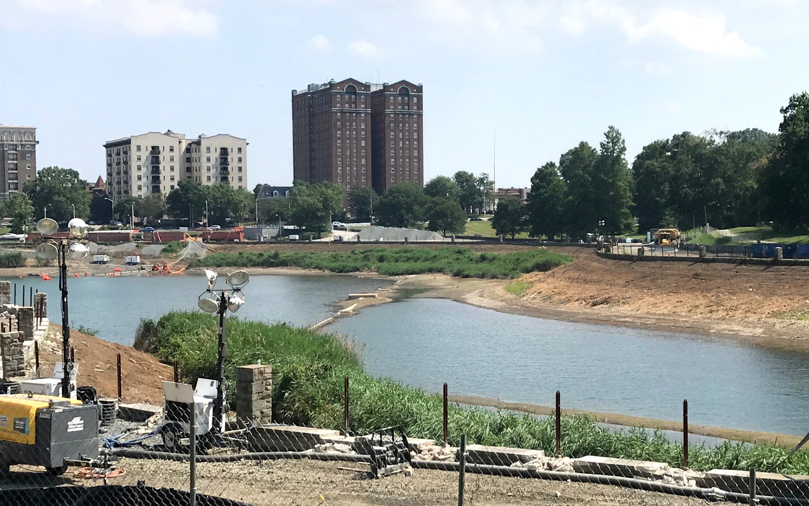 The draining of the western end of Druid Lake, where water storage tanks will eventually be buried, has resulted in illegal discharges of chlorinated water into the nearby Jones Falls, according to state regulators. (Mark Reutter)
