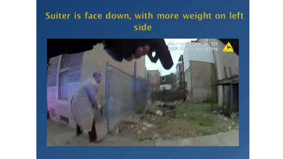 Still from Officer Santiago's body-worn camera showing Santiago's gun drawn, as Detective Bomenka approaches Detective Suiter's motionless body. (Independent Review Board Final Report on the death of Sean Suiter)