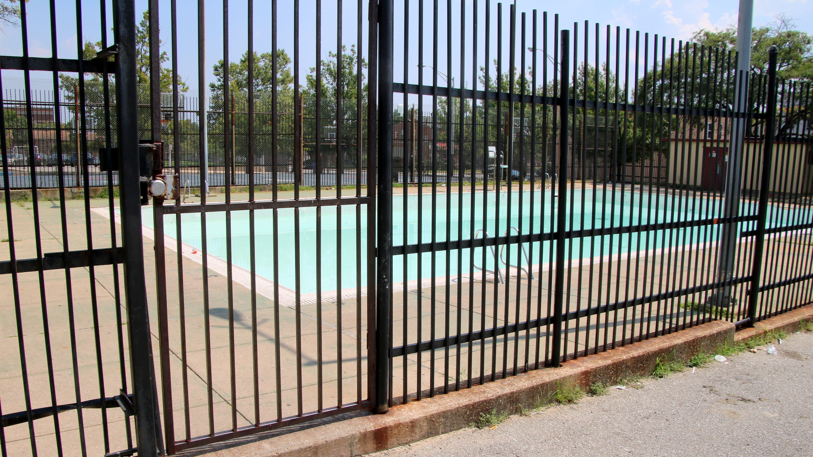 The William McAbee pool in West Baltimore is closed for the summer, with a week of summer vacation still to go for city school students. (Fern Shen)