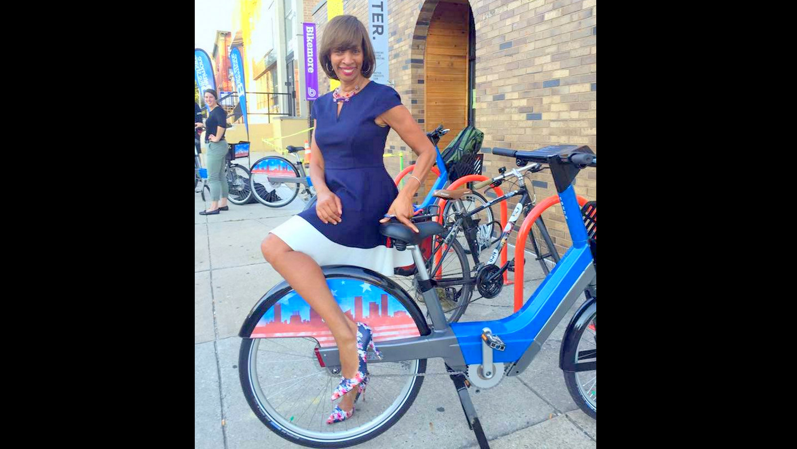 Happier times. Then mayoral candidate Catherine Pugh posing with a Baltimore Bikeshare bike in 2016.