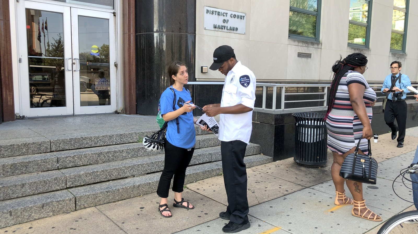 Rianna Eckel passing along information on Baltimore's new rules for rental housing. (Fern Shen)