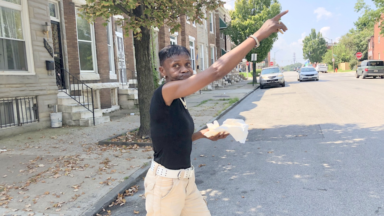 Neighborhood kids need relief from the heat, said Tonya Smith, pointing to the padlocked William McAbee pool on Gimore Street in West Baltimore. (Fern Shen)