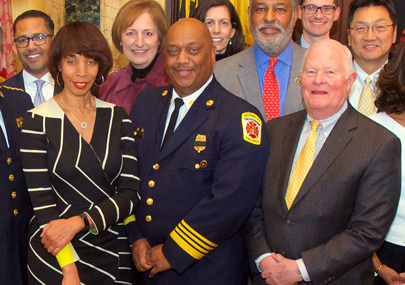 Mayor Catherine Pugh poses with Jim Smith (separated by Fire Chief Niles Ford) at the Christmas 2017 photo of her cabinet. (Mayor's Office)