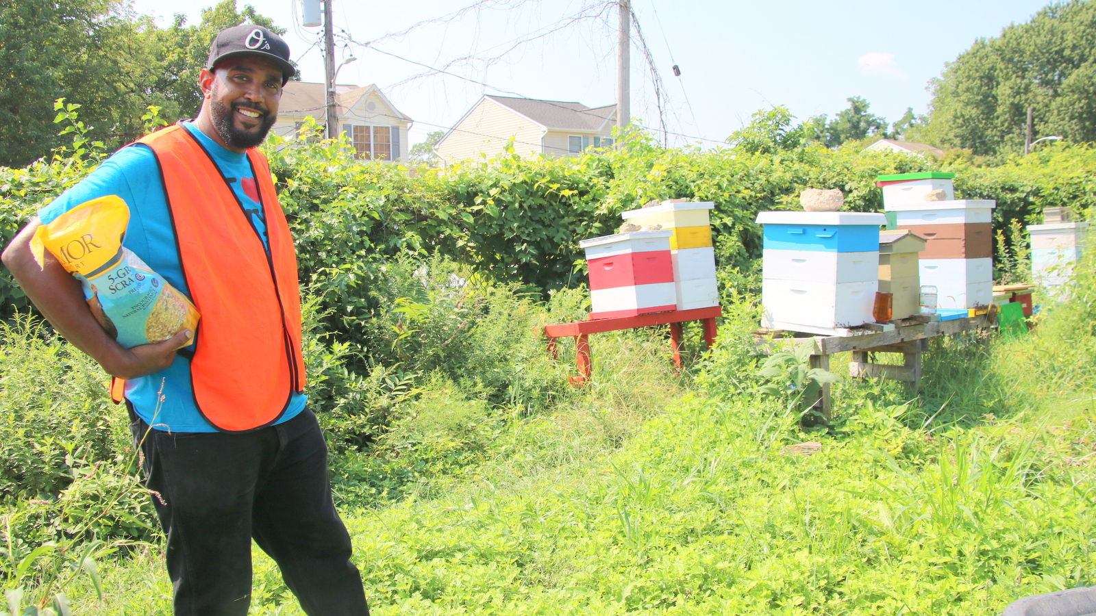 Honey from the apiary is another Filbert Street Community Garden product, Marvin Hayes explained. (Fern Shen)