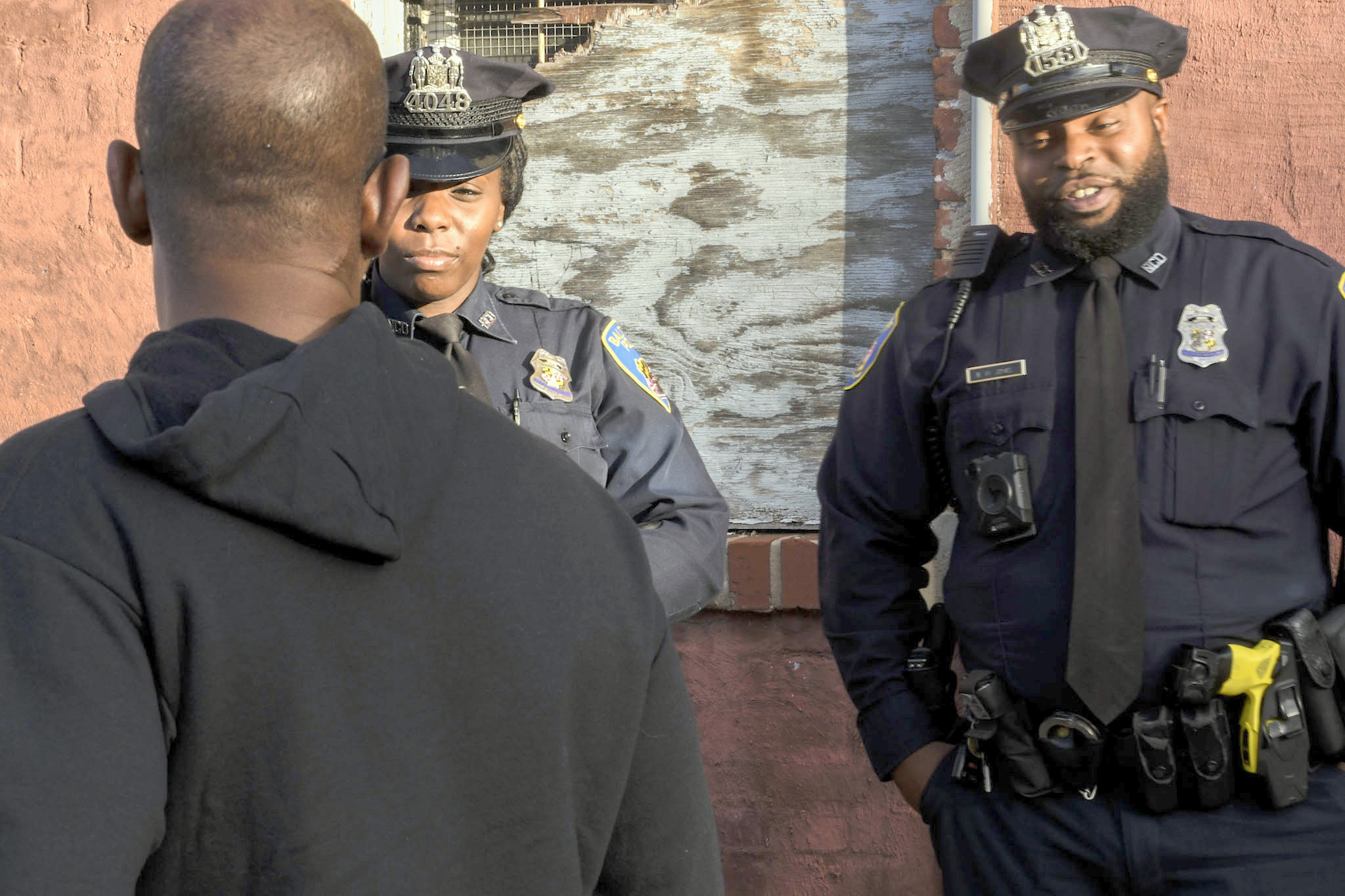 Baltimore Police and residents toured the back alleys and by-ways of Sandtown-Winchester. (J.M. Giordano)