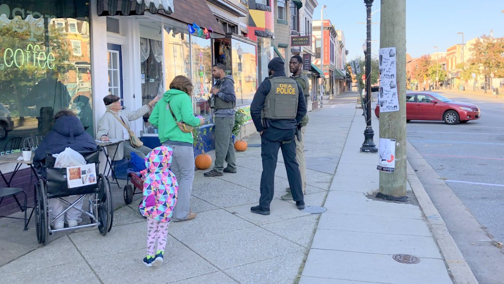 Drug Enforcement Administration agents caught the eye of kids and coffee drinkers in downtown Hampden. (Fern Shen)