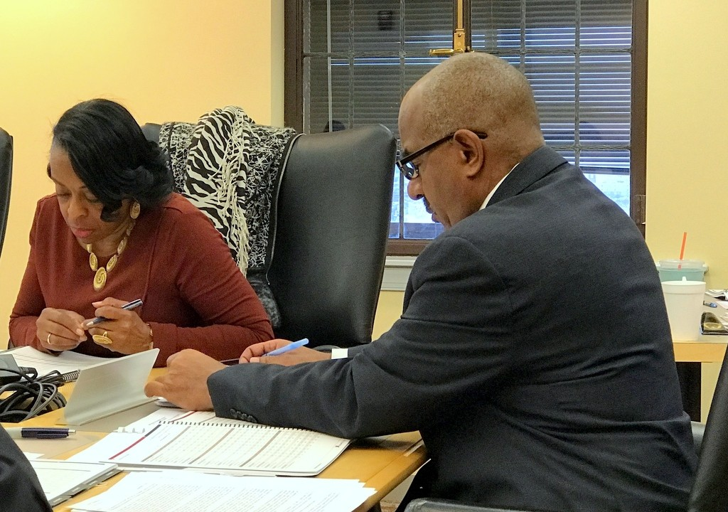 ERS vice chair Joan Pratt and acting director David Randall review investment returns presented at yesterday's meeting. (Mark Reutter)