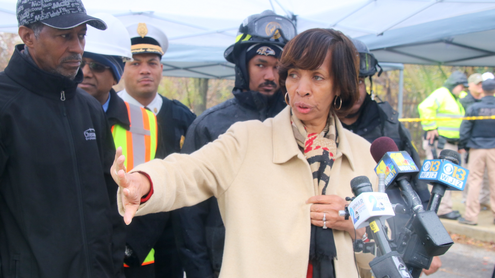 Mayor Catherine Pugh speaks to reporters near a part of 26th street that began sinking today amid heavy rain. (Fern Shen)