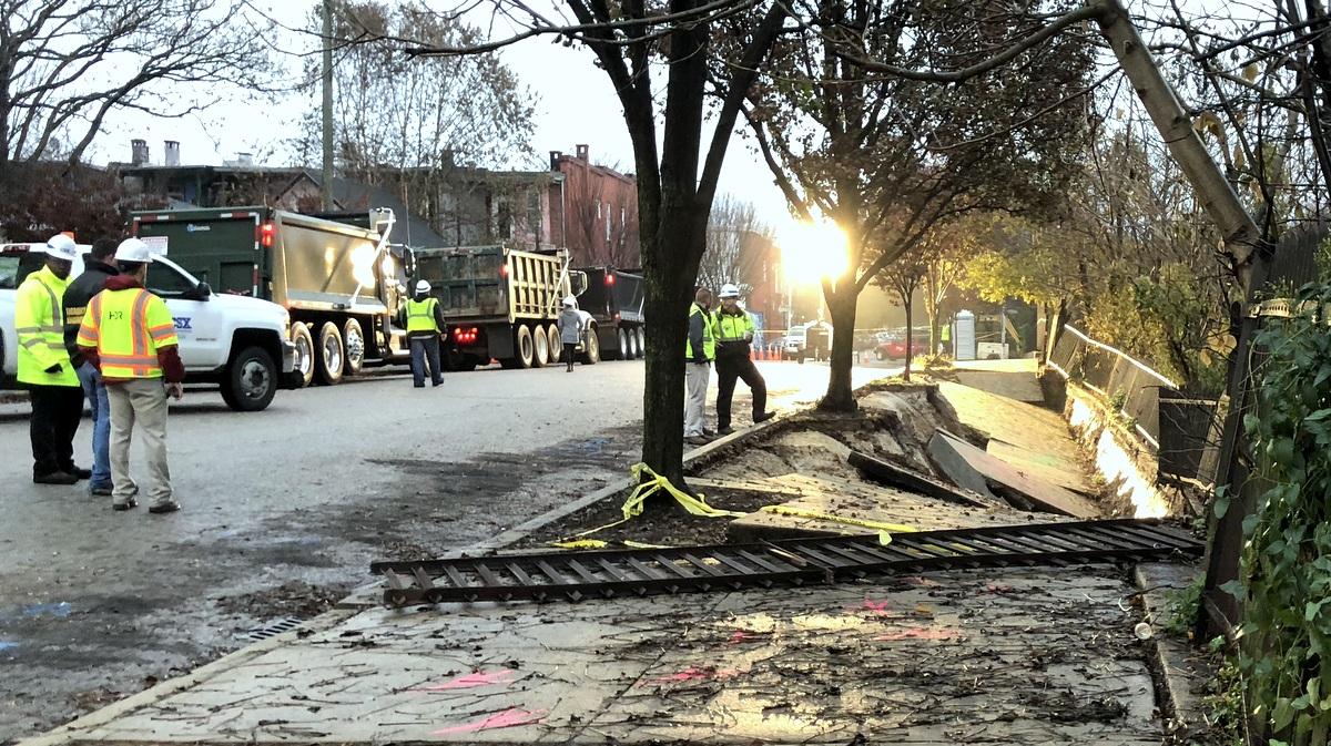 The slumping sidewalk at 4:30 today. (fern Shen)