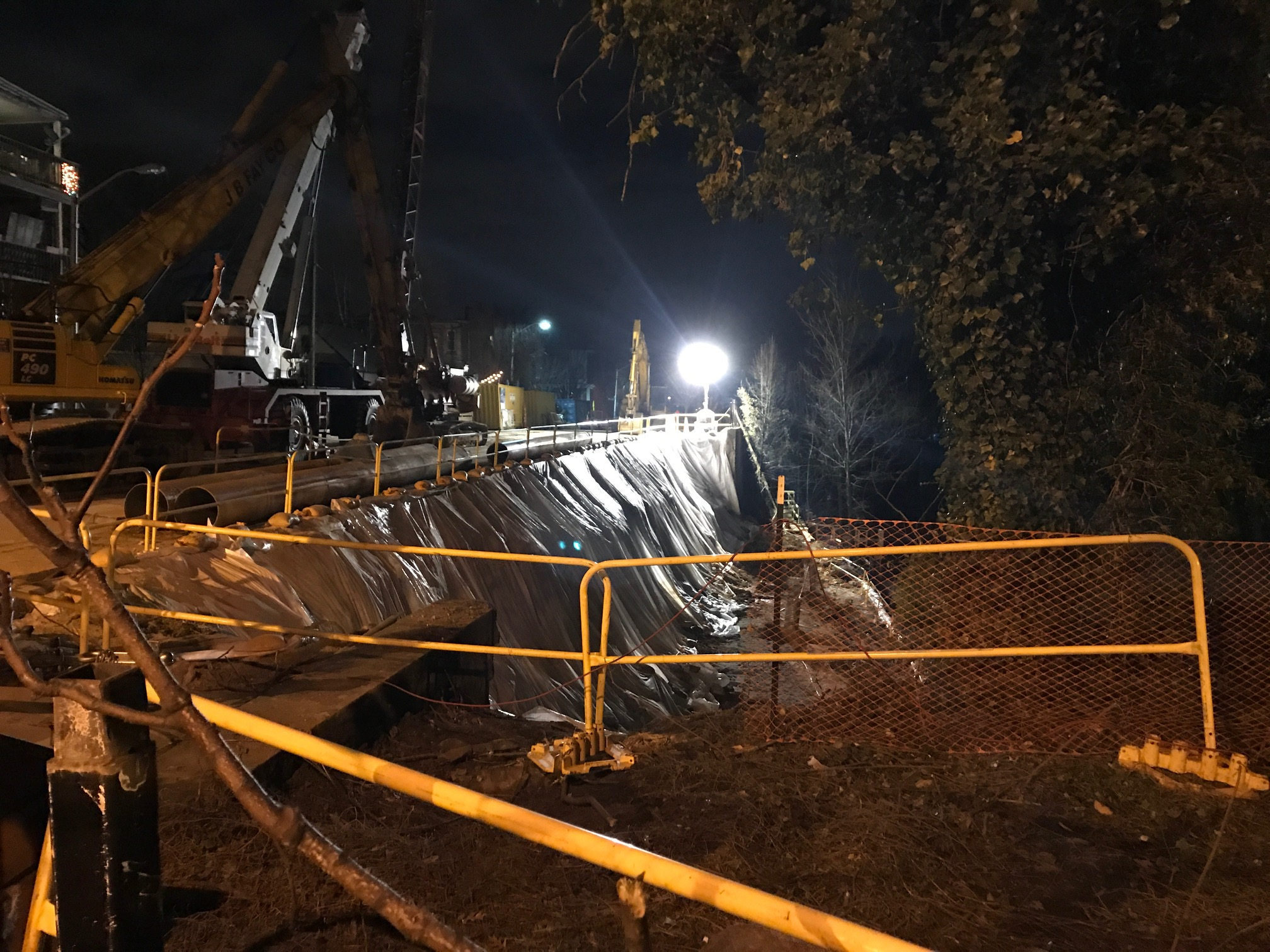 The steep slope down to CSX tracks has been stabilized and a new retaining wall is expected to be completed until next summer. Here was the scene last night. (Mark Reutter)