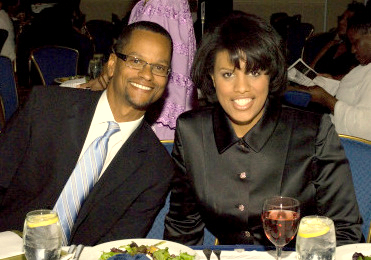 Kevin Johnson seated with then-Mayor Rawlings-Blake at a 2011 Urban League gala whee he won an award for