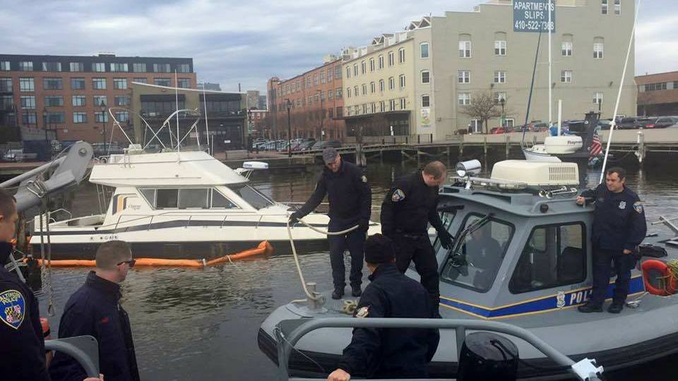 The Urban Rescue Team and Marine Unit work to clear pilings as part of a months-long operation to remove the vessel Danger Zone from its mooring off Fells Point. (Facebook)