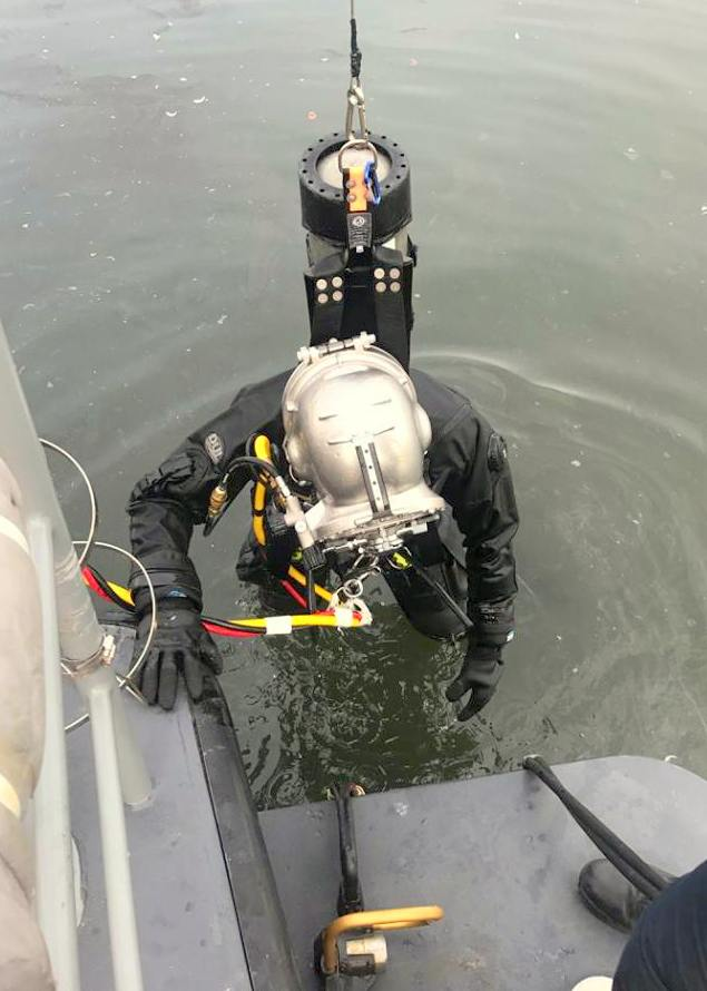 Sgt. Roepcke with the underwater chainsaw used to cut pilings away from the hull. (Facebook)