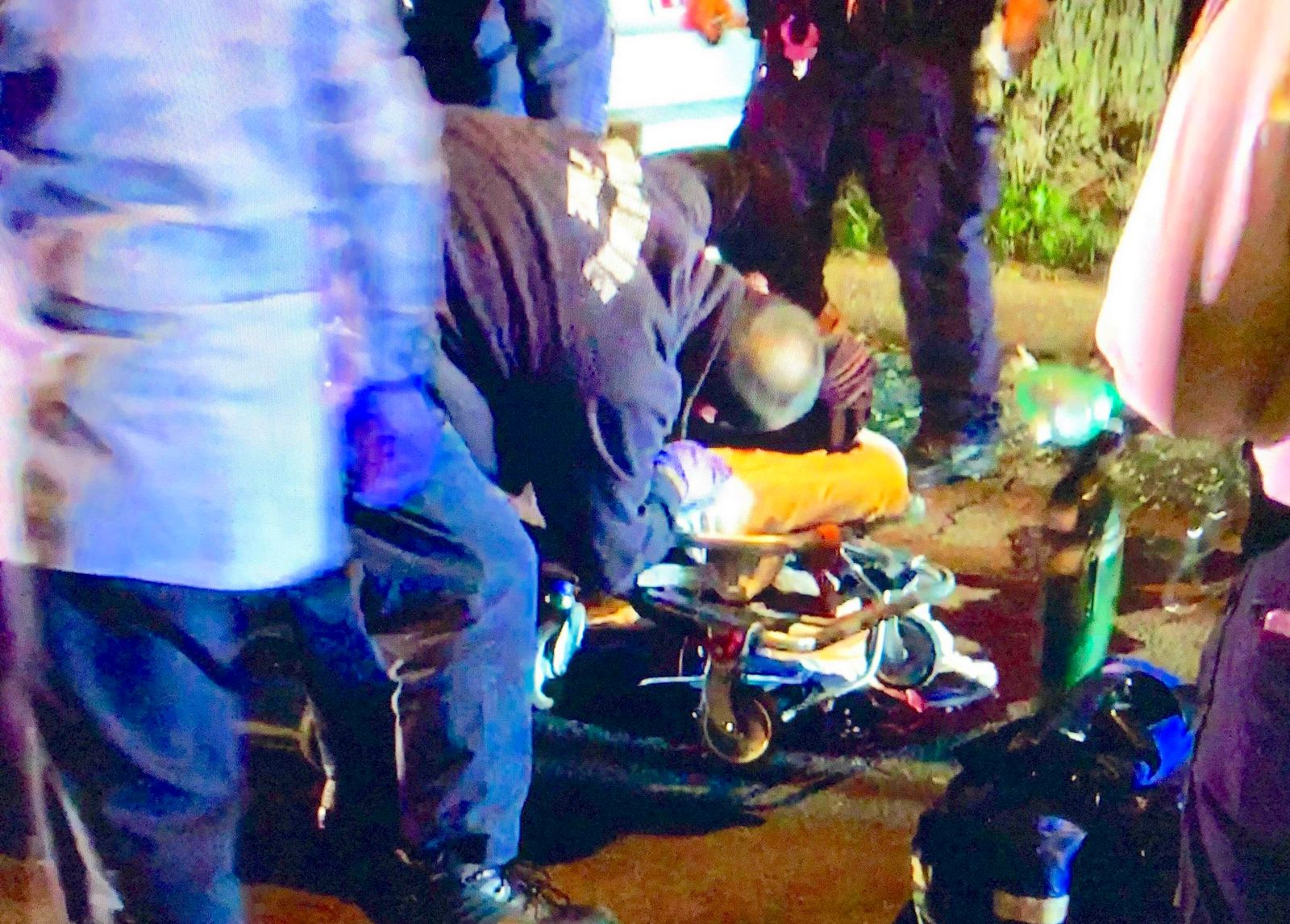 Paramedics attempt to save a 2016 shooting victim. (Photo credit: Christopher Ervin)
