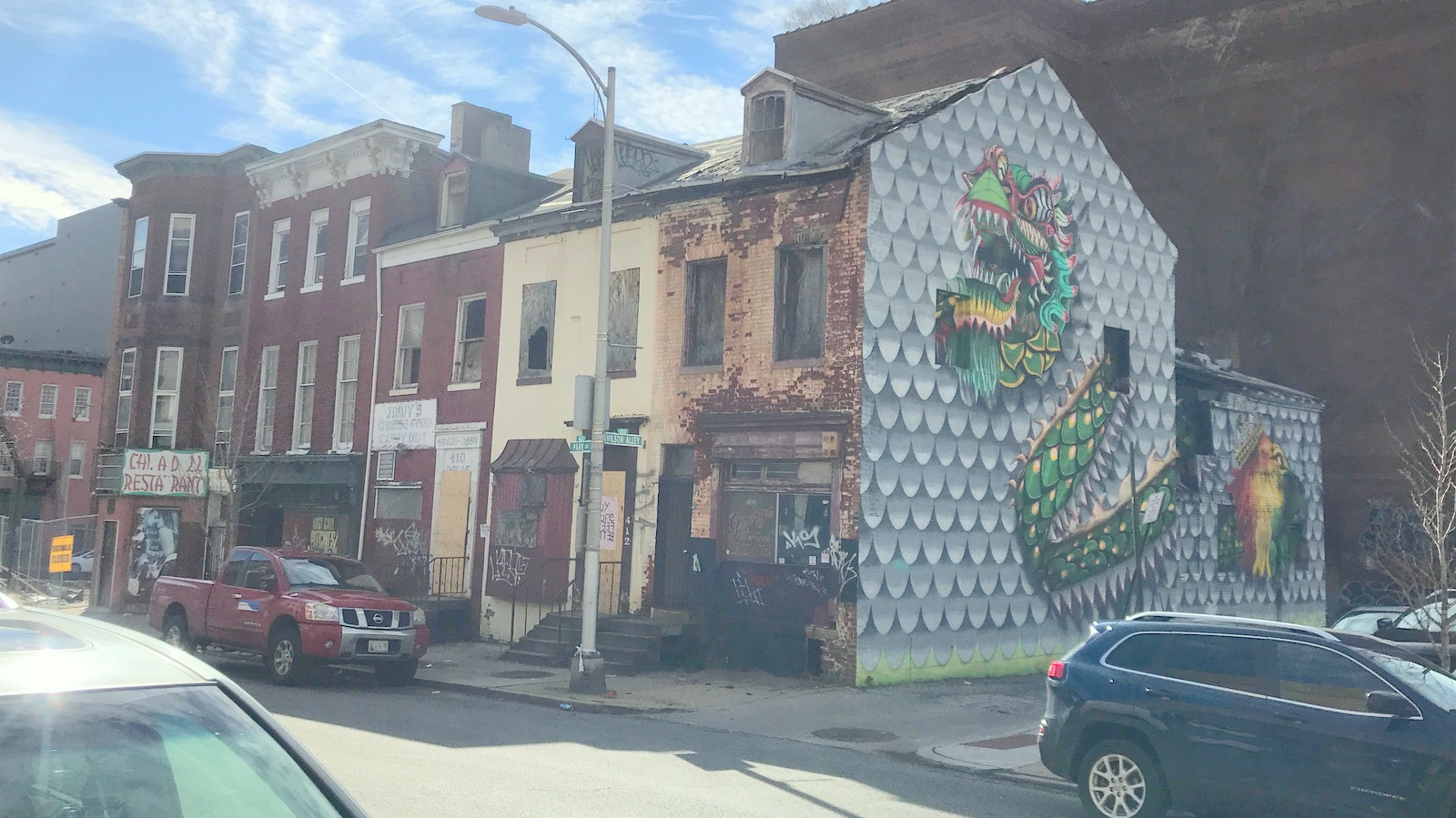 Building facades on this block on Baltimore's Park Street would be preserved and the spaces leased to Asian-themed eateries, the developer says. (Chase Hoffberger)