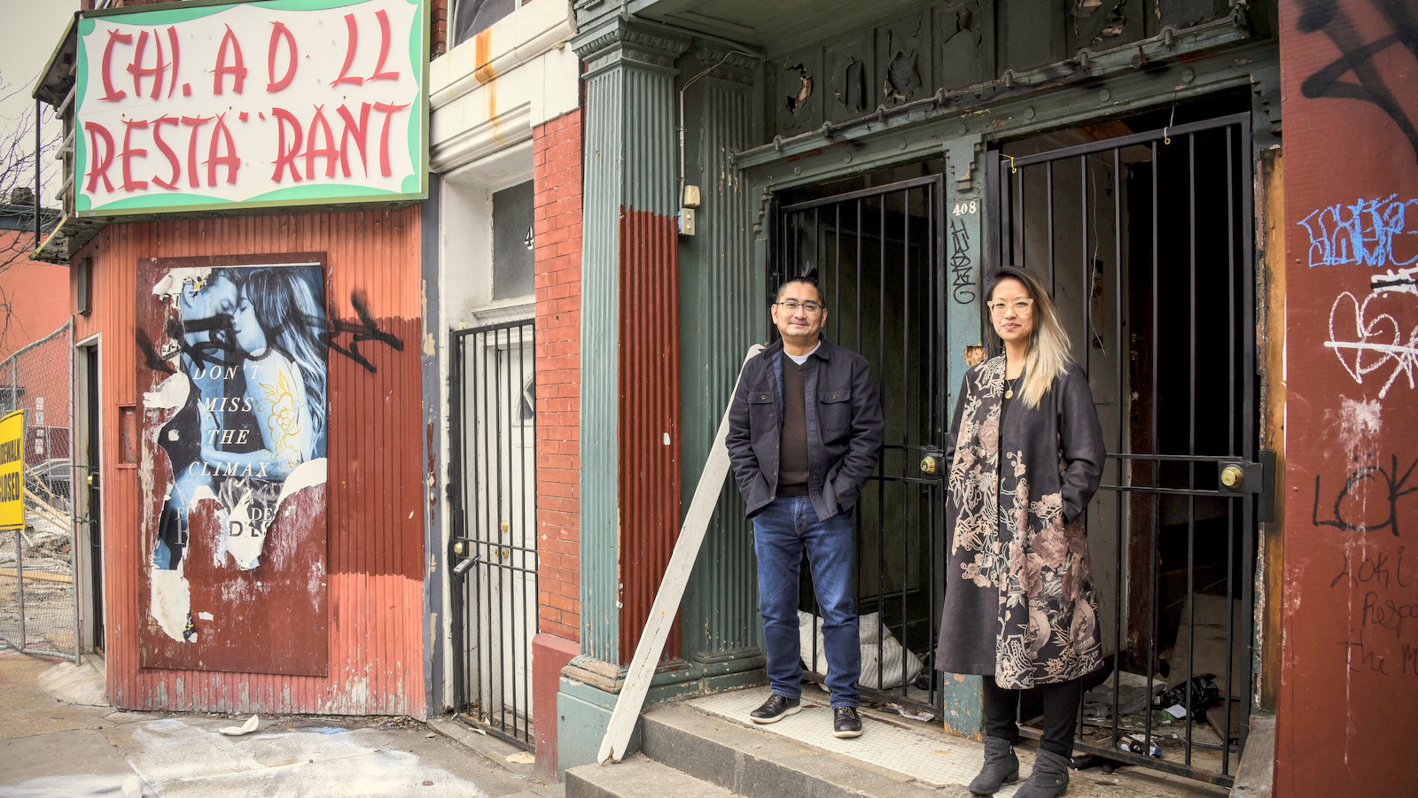Leandro Lagera and Stephanie Hsu, members of the Chinatown Collective, in the 400 block of Baltimore's Park Avenue. (J.M. Giordano)