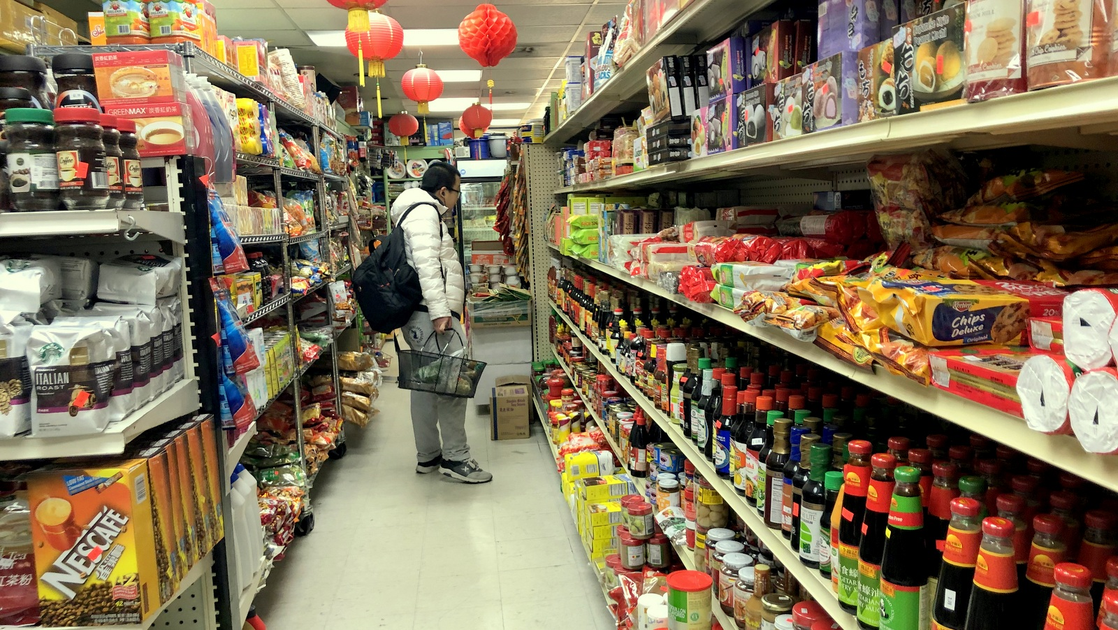Asian and Middle Eastern people, students and Ethiopians from the neighborhood are among the customers at Po Tung Oriental Grocery, Baltimore Chinatown's only market. (Fern Shen)
