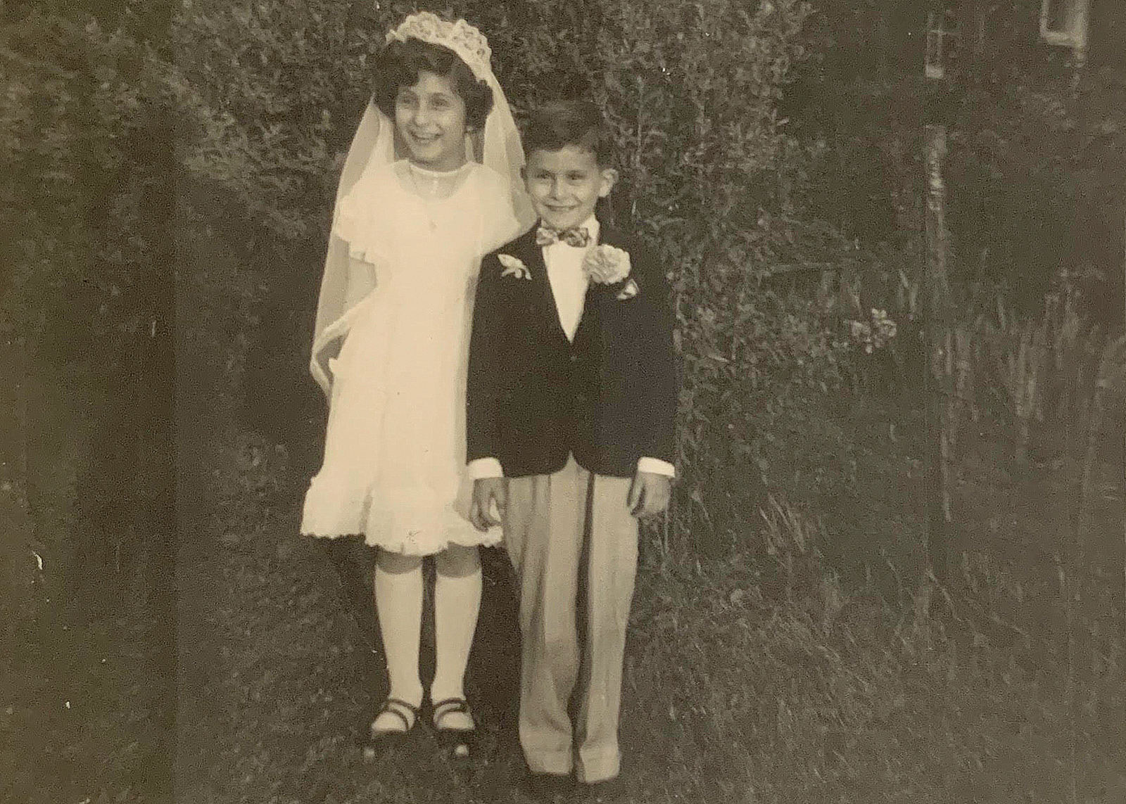Dona Bartoli, First Communion, 1949, with her brother Bernie. (Family photo)