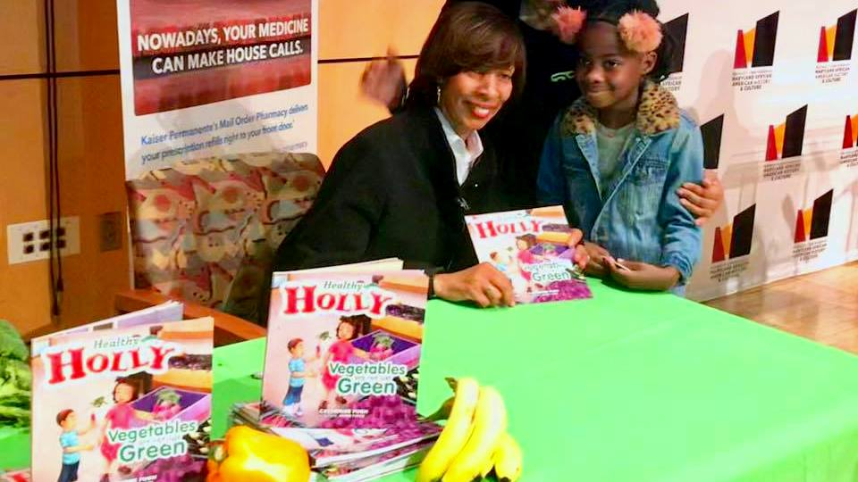 Mayor Catherine Pugh at the Reginald Lewis Museum last year, signed copies of her book for children. (Facebook)