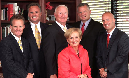 Francis X. Kelly (center) with his wife Janet and his four sons, who now run the day-to-day insurance business. (prnewswire.com)