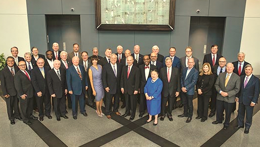 The UMMS board is dominated by elderly businessmen and lawyers. Among the few women on the board were Mayor Catherine Pugh (striped dress), who resigned yesterday following revelations of payments by UMMS to support her