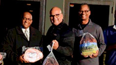 Council President Young (at left) and Kevin Johnson (right) at a 2016 Thanksgiving turkey donation event. (Jack's Journal 11/23/16)