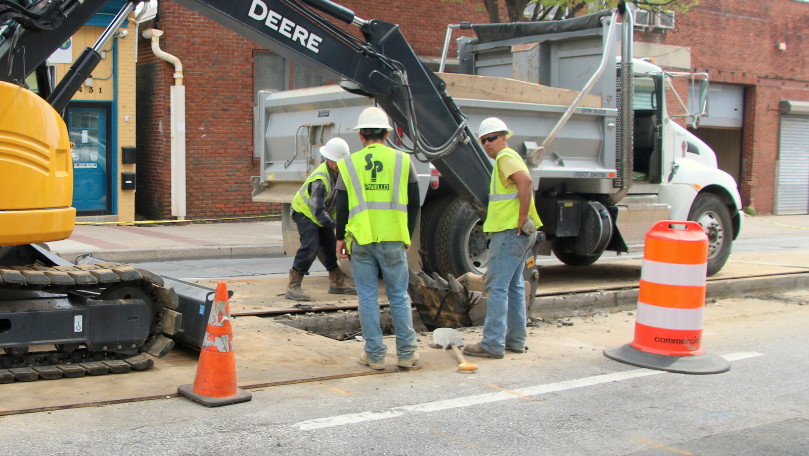 Spiniello company workers on Greenmount Avenue s part of an overhaul of Baltimore's underground conduits. (Fern Shen)